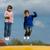 crianças · trampolim · ginásio · ajuda · outro - foto stock © bigandt