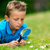Boy with magnifying glass in garden stock photo © bigandt