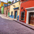 Red Pink Colorful Houses Narrow Street Guanajuato Mexico stock photo © billperry