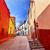 many colored red yellow houses narrow street guanajuato mexico stock photo © billperry