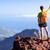 Hiking success, hiking backpacker man in mountains stock photo © blasbike