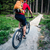 Mountain biker cycling riding in summer forest stock photo © blasbike