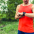 Runner looking at sport smart gps watch stock photo © blasbike