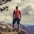 hiking man or trail runner in inspiring mountains stock photo © blasbike