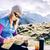 woman checking map hiking in mountains stock photo © blasbike