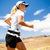 young woman running in mountains on sunny summer day stock photo © blasbike