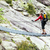 woman trekking with backpack crossing bridge stock photo © blasbike