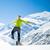 mensen · naar · zonsondergang · winter · bergen · gedekt - stockfoto © blasbike