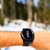 runner on mountain trail looking at stopwatch activity tracker stock photo © blasbike