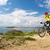 mountain biker riding on bike at the sea and summer mountains stock photo © blasbike