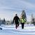 couple hiking on snow in winter mountains stock photo © blasbike