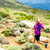 happy woman trail running in beautiful mountains stock photo © blasbike