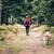 boldog · nő · kirándulás · sétál · kutya · erdő - stock fotó © blasbike