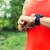 Man running and checking sport smart watch stock photo © blasbike