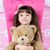 little girl hugging teddy bear stock photo © bloodua