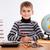 Cute schoolboy is writting stock photo © bloodua