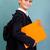 ute schoolboy is holding an orange book stock photo © bloodua