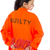 rear view of a asian young woman holding a red love text in prisoners uniform stock photo © bmonteny