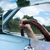 Reflection of a human's hand in the mirror of a car stock photo © bmonteny
