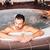 pár · jacuzzi · fürdő · pihen · víz · szeretet - stock fotó © boggy