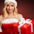 beautiful girl with gift wearing santa claus clothes stock photo © bogumil