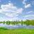 güneşli · bahar · manzara · nehir · bulutlar · mavi · gökyüzü - stok fotoğraf © bogumil