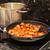 cocina · estufa · llama · sartén · mano - foto stock © brebca
