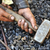 detail of dirty hands holding hammer   blacksmith stock photo © brozova
