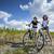 iki · güzel · kızlar · bisiklet · tur · kaya - stok fotoğraf © BrunoWeltmann