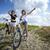 güzel · kız · bisiklet · göstermek · yön · iki - stok fotoğraf © BrunoWeltmann