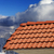 roof tiles against winter mountains stock photo © bsani