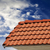 Roof tiles and sky with clouds at sunny day stock photo © BSANI