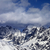 high snowy mountains in clouds at sunny day stock photo © bsani