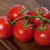 bunch of fresh tomatoes with water drops on wooden table stock photo © bsani