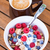 Cornflakes with fresh fruits, yogurt and coffee stock photo © bubutu