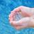 Human hands splashing pure water stock photo © burtsevserge