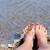 nő · láb · közelkép · lány · megnyugtató · tengerpart - stock fotó © byrdyak