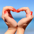 female hand making a heart shape against stock photo © byrdyak
