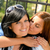 daughter kissing her mother outdoors teen happy stock photo © candyboxphoto