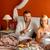 sitting happy husband wife bed drinking tea stock photo © candyboxphoto