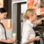 two waitresses serving coffee with machine stock photo © candyboxphoto