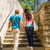 couple climbing up city stairs holding hands stock photo © candyboxphoto