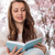 student reading book near blossoming tree spring stock photo © candyboxphoto