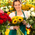 smiling florist woman bouquet sunflowers flower shop stock photo © candyboxphoto
