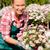 женщину · розовый · цветы · улыбаясь · улыбка - Сток-фото © candyboxphoto