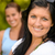 mother smiling with teen daughter in background stock photo © candyboxphoto