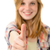 young smiling girl showing thumbs up stock photo © candyboxphoto