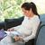 женщину · диван · чтение · журнала · гостиной · окна - Сток-фото © candyboxphoto
