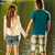 teenage couple standing in water holding hands stock photo © candyboxphoto