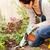 woman kneeling planting garden hobby rake plants stock photo © candyboxphoto